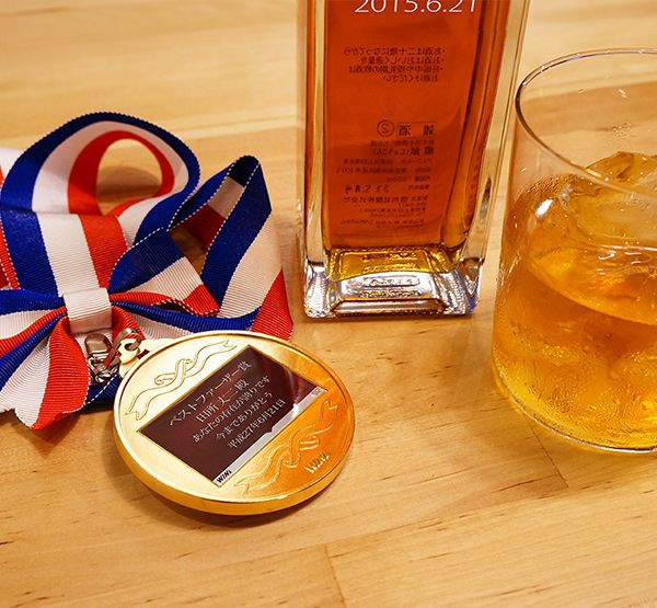 喜寿祝いに金メダルの贈り物